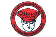 Oilzum oil patches are orange, white, and black.